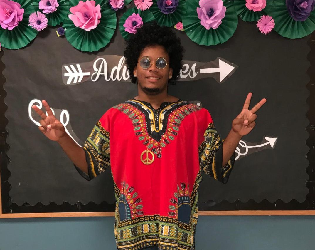 Senior Joseph Moore spreads peace, love, and good vibes on hippie day during homecoming spirit week.