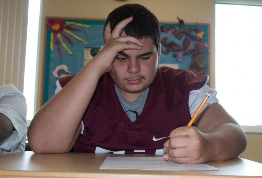 Freshman%2C+Nikko+Rodriguez%2C+stares+at+his+paper+with+a+look+of+frustration+on+his+face.+He+suffers+from+ADHD+and+has+trouble+focusing+in+school+because+of+his+condition.+
