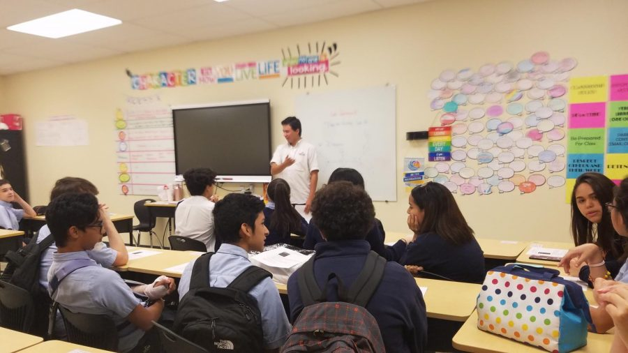 Interact+clubs%E2%80%99+class+president+Andrey+Cuevas+Andreev+gives+a+speech+to+the+other+club+members.+