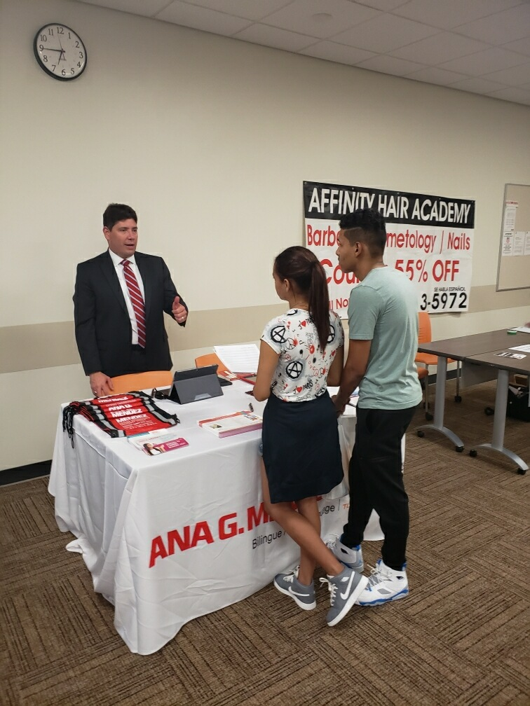 Juniors Sebastian Vargas and Neileen Acosta speak with a rep from Ana G Mendez University about their application process.
