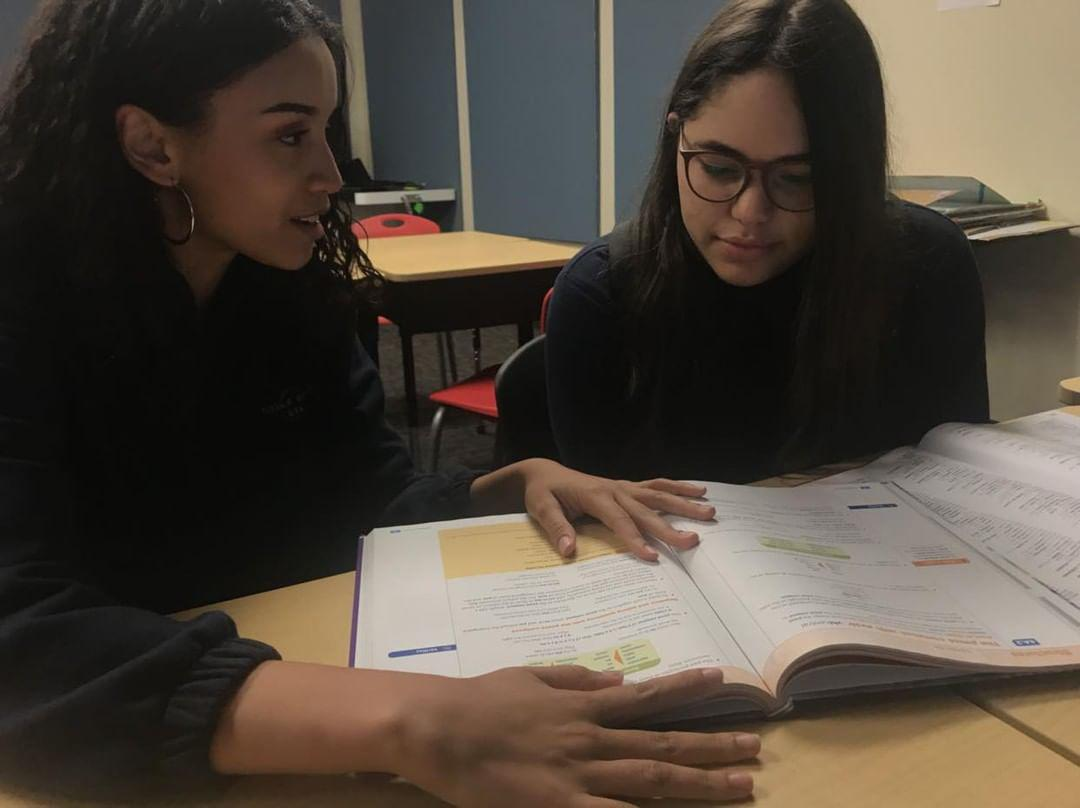 Club members, senior, Kayla Montan, and junior, Tiffany Valentin, reviewing French words