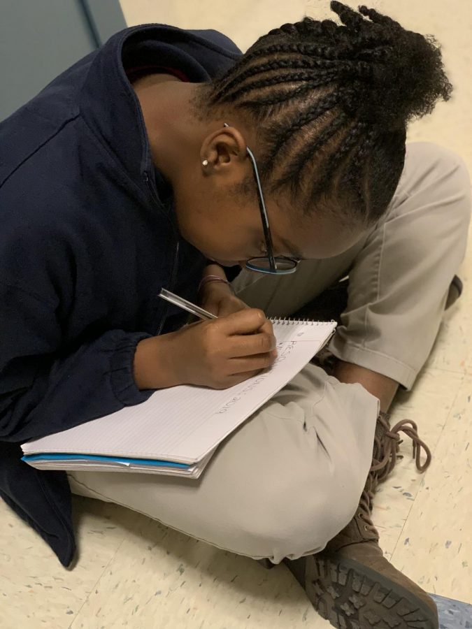 6th grade, Tatianna Hutchinson, plans out her New Year's resolutions for 2019.