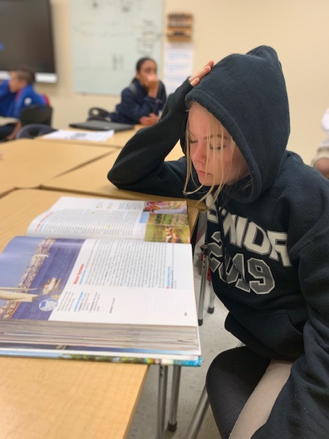Freshman+Courtney+Goss+reading+over+work%2C+trying+not+to+fall+asleep.