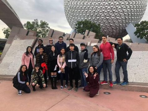 French club students posing in front of the Epcot ball.