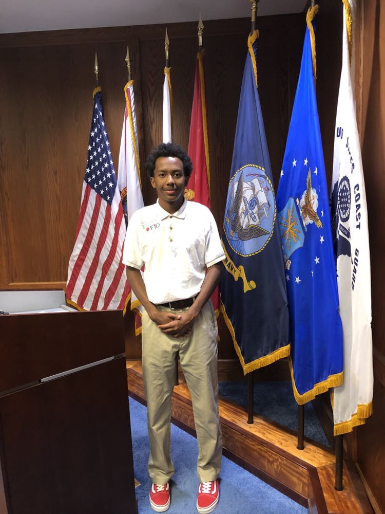Karlo is sworn into the Navy.