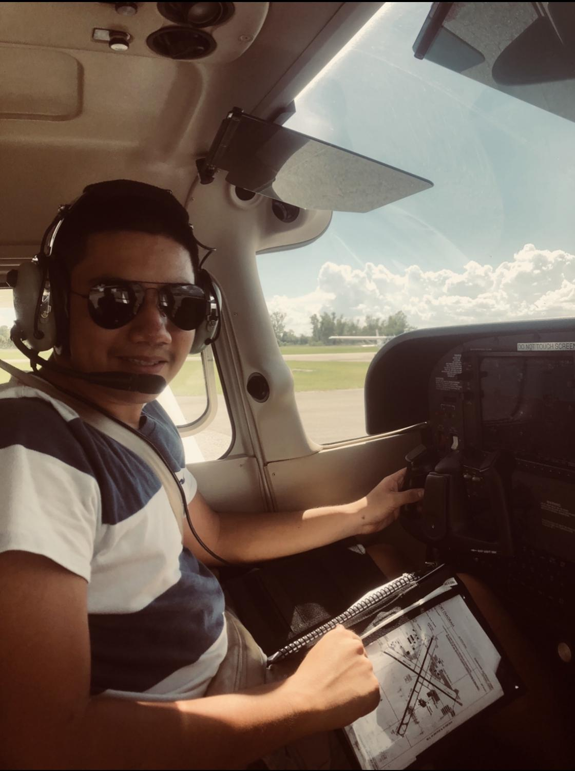 Senior Daniel Rodriguez sits in the pilot seat of an airplane at the Kissimmee Gateway Airport.