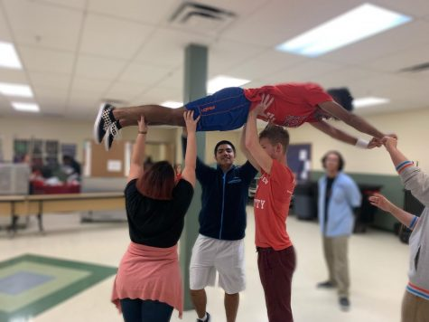 Seniors Dylan Goss, Daniel Rodriguez, and Iancarlo Ayala practice a lift during rehearsals with director Mrs. Julie Gardieff.