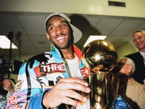 Kobe Bryant celebrates with the Larry O' Brien trophy after winning his 3rd NBA Championship in a row, the infamous