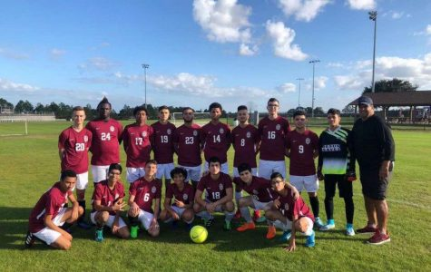 Senior, Justin Padron poses with his soccer team after a tough game.