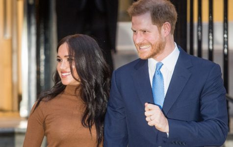 Harry Charles and Meghan Markle pose for photo.