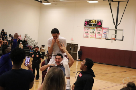 Sophomore Victor Dones is lifted in celebration after winning the first ever basketball playoff game.