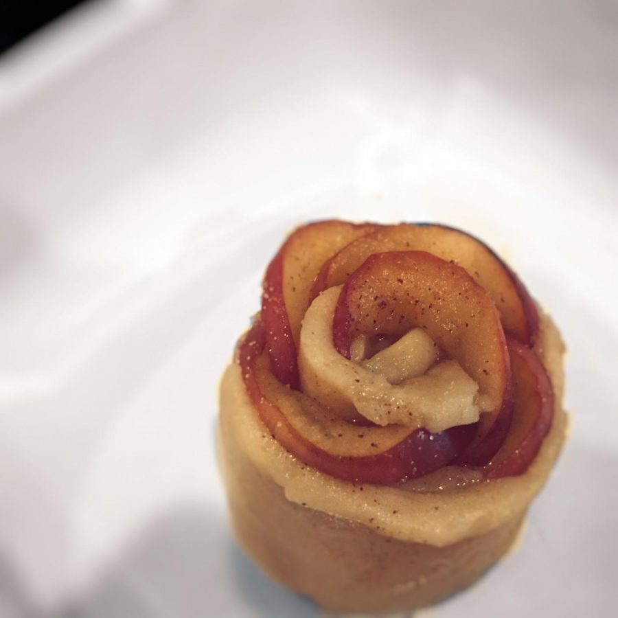 Apple rose made from pie dough and apple filling.