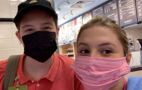 Juniors Gracey Davis and Chloe Webber at their job during quarantine.