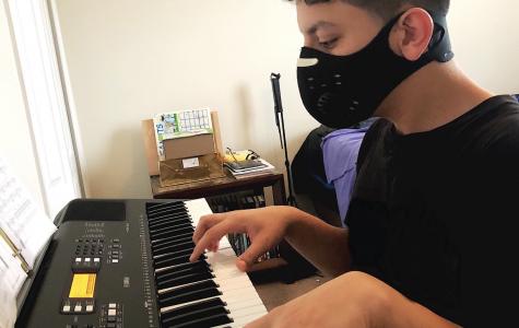 A&E Editor Patrick Deliz practices piano.