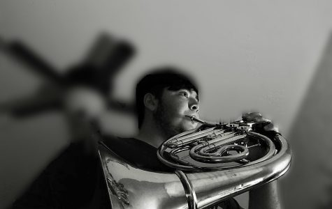 Jonathan Polohronakis playing the French Horn.