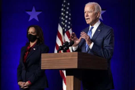 Former Vice President Joe Biden speaks Friday in Wilmington, Del., as his running mate, California Sen. Kamala Harris, listens.