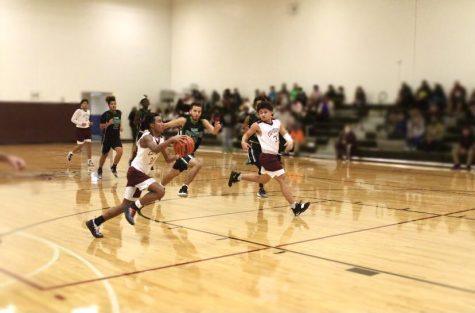 Junior, Jaonie Delacruz keeping his head in the game, and determined to take every open shot.